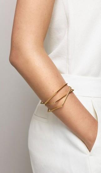 trend gioielli bracciali oro dorati maxi sottilii rigidi