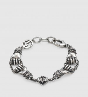 gioielli gucci argento bracciale mani